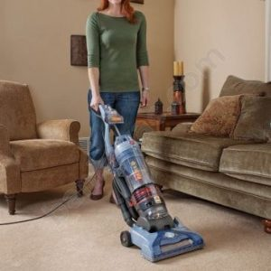 woman using in living room HOOVER T-Series WindTunnel Rewind Bagless Upright