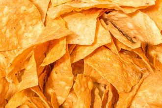 High levels of sodium make both potato and tortilla chips dangerous for your cat